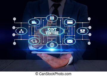 Text sign showing Joint Venture. Business photo text Collaboration Arrangement Parties Partnership Team Male human wear formal work suit presenting presentation using smart device