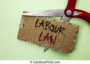 Text sign showing Labour Law. Conceptual photo Employment Rules Worker Rights Obligations Legislation Union written on Tear Cardboard on the plain background with Scissor.