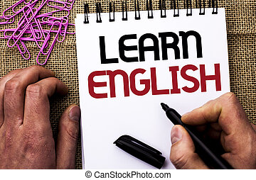 Text sign showing Learn English. Conceptual photo Study another Language Learn Something Foreign Communication written by Man Holding Marker on Notebook Book on the jute background Pins next to it