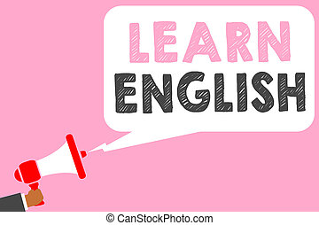 Text sign showing Learn English. Conceptual photo Universal Language Easy Communication and Understand Man holding megaphone loudspeaker speech bubble message speaking loud.