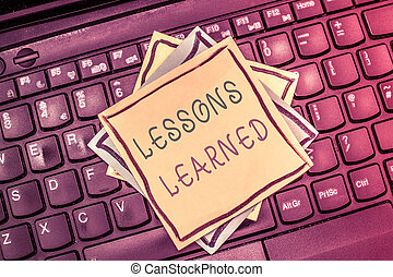Text sign showing Lessons Learned. Conceptual photo Promote...