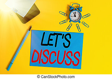 Text sign showing Let Discuss. Conceptual photo asking someone to talk about something with demonstrating or showing Smartphone clock clips paper sheet notepad ballpoint colored background.