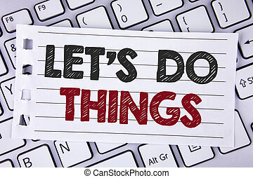 Text sign showing Let Us Do Things. Conceptual photo Try something new find happiness mastering it by practice written on Notebook paper placed on the Laptop.
