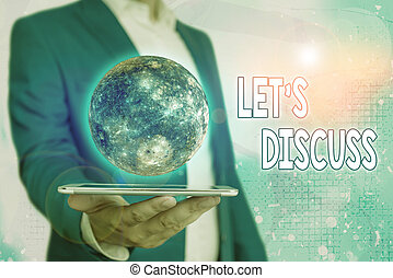 Text sign showing Lets Discuss. Conceptual photo asking someone to talk about something with demonstrating or showing Elements of this image furnished by NASA.