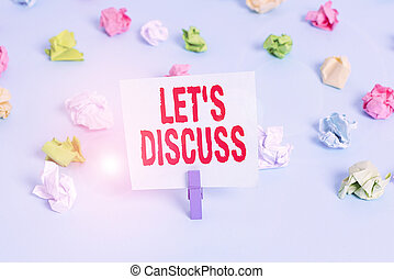 Text sign showing Lets Discuss. Conceptual photo asking someone to talk about something with demonstrating or showing Colored crumpled papers empty reminder blue floor background clothespin.