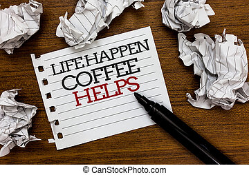 Text sign showing Life Happen Coffee Helps. Conceptual photo Have a hot drink when having problems troubles Paper lumps laid randomly around white notepad touch black pen on woody floor
