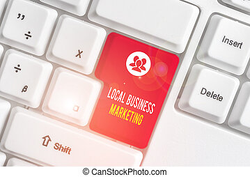 Text sign showing Local Business Marketing. Business photo text Localized specification on Store characteristic White pc keyboard with empty note paper above white background key copy space