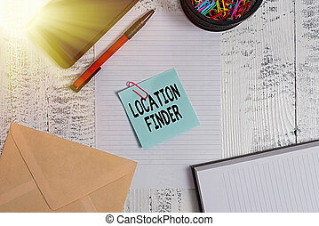 Text sign showing Location Finder. Business photo showcasing A service featured to find the address of a selected place Smartphone sheet clips ballpoint notebook envelope note wooden background