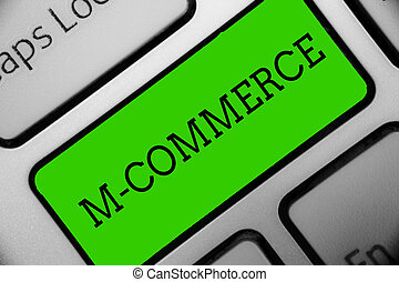 Text sign showing M Commerce. Conceptual photo commercial transactions conducted electronically by mobile phone Keyboard green key Intention create computer computing reflection document.