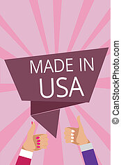 Text sign showing Made In Usa. Conceptual photo American brand United States Manufactured Local product Man woman hands thumbs up approval speech bubble origami rays background.