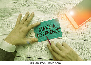 Text sign showing Make A Difference. Conceptual photo have significant effect or non on demonstrating or situation Hand hold note paper near writing equipment and modern smartphone device.