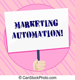 Text sign showing Marketing Automation. Conceptual photo Software used by company to effectively target customer Hand Holding Blank White Placard Supported by Handle for Social Awareness.
