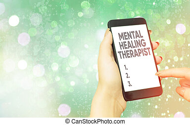 Text sign showing Mental Healing Therapist. Conceptual photo helping an individual express emotions in healthy ways Modern gadgets with white display screen under colorful bokeh background.