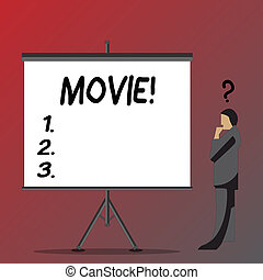 Text sign showing Movie. Business photo showcasing Cinema or television film Motion picture Video displayed on screen Businessman with Question Mark Above his Head Standing Beside Blank Screen