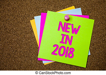 Text sign showing New In 2018. Conceptual photo upcoming year resolution Advertising new product Specs Postcards various colour brown background lovely thoughts message memories.