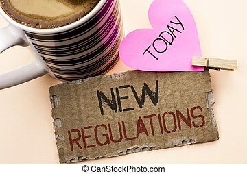 Text sign showing New Regulations. Conceptual photo Change of Laws Rules Corporate Standards Specifications written on Tear Cardboard Piece on the plain background Pink Heart and Coffee Cup.