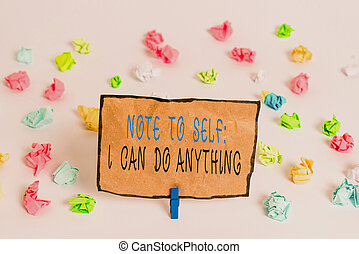 Text sign showing Note To Self I Can Do Anything. Conceptual photo Motivation for doing something confidence Colored crumpled papers empty reminder white floor background clothespin.