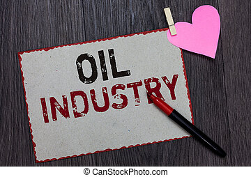 Text sign showing Oil Industry. Conceptual photo Exploration Extraction Refining Marketing petroleum products White page red borders marker clothespin holds paper heart wood background.