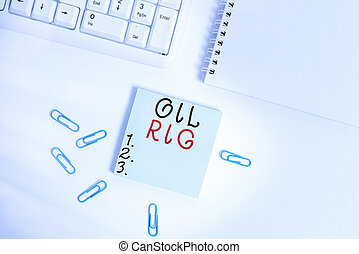 Text sign showing Oil Rig. Conceptual photo large structure with equipment to remove oil from under the seabed Empty note paper on the white background by the pc keyboard with copy space.