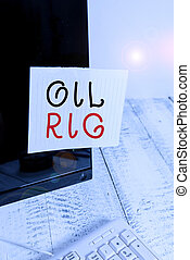 Text sign showing Oil Rig. Conceptual photo large structure with equipment to remove oil from under the seabed Notation paper taped to black computer monitor screen near white keyboard.
