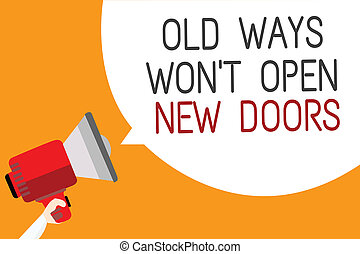 Text sign showing Old Ways Won t not Open New Doors. Conceptual photo be different and unique to Achieve goals Man holding megaphone loudspeaker speech bubble message orange background.