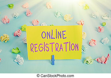 Text sign showing Online Registration. Conceptual photo Process to Subscribe to Join an event club via Internet Colored crumpled papers empty reminder blue floor background clothespin.