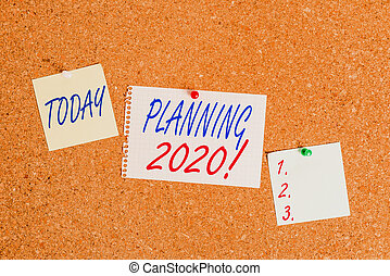 Text sign showing Planning 2020. Conceptual photo process of making plans for something next year Corkboard color size paper pin thumbtack tack sheet billboard notice board.