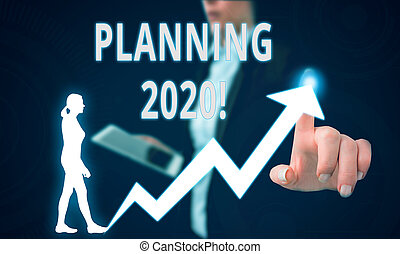 Text sign showing Planning 2020. Conceptual photo process of making plans for something next year Female human wear formal work suit presenting presentation use smart device.