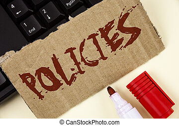 Text sign showing Policies. Conceptual photo Business Company or Government Rules Regulations Standards written on Tear Cardboard Piece on plain background Keyboard and Marker next to it.