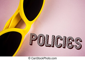 Text sign showing Policies. Conceptual photo Business Company or Government Rules Regulations Standards written on Plain Pink background Sunglasses next to it.