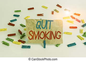 Text sign showing Quit Smoking. Conceptual photo process of discontinuing tobacco smoking or cessation Colored clothespin papers empty reminder white floor background office.