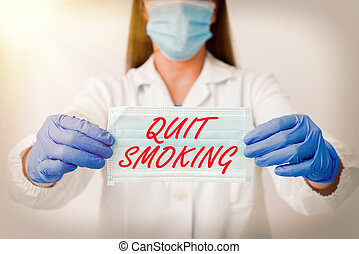 Text sign showing Quit Smoking. Conceptual photo the process of discontinuing or stopping tobacco smoking Laboratory blood test sample shown for medical diagnostic analysis result.
