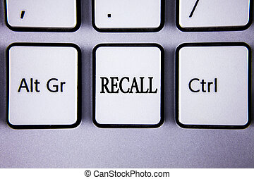 Text sign showing Recall. Conceptual photo Bring back to memory Ordering the return of a person or product written on White Keyboard Key with copy space. Top view.