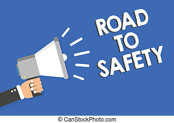 Text sign showing Road To Safety. Conceptual photo Secure travel protect yourself and others Warning Caution Man holding megaphone loudspeaker blue background message speaking loud.