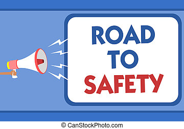 Text sign showing Road To Safety. Conceptual photo Secure travel protect yourself and others Warning Caution Man holding megaphone loudspeaker speech bubble message speaking loud.