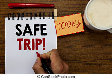 Text sign showing Safe Trip. Conceptual photo wishing someone to reach his destination in good health Man holding marker notebook clothespin reminder wooden table cup coffee.