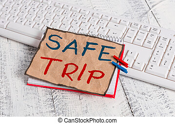 Text sign showing Safe Trip. Conceptual photo wishing someone to reach his destination in good health notebook paper reminder clothespin pinned sheet white keyboard light wooden.