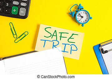 Text sign showing Safe Trip. Conceptual photo wishing someone to reach his destination in good health Empty orange paper with copy space on the yellow table.