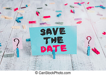 Text sign showing Save The Date question. Conceptual photo asking someone to remember specific day or time Scribbled and crumbling sheet with paper clips placed on the wooden table.