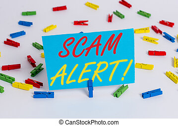 Text sign showing Scam Alert. Conceptual photo fraudulently obtain money from victim by persuading him Colored clothespin papers empty reminder white floor background office.