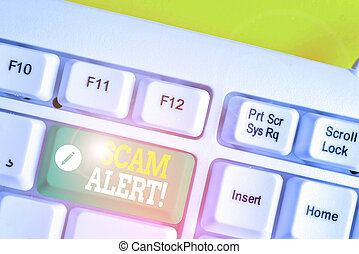 Text sign showing Scam Alert. Conceptual photo fraudulently obtain money from victim by persuading him White pc keyboard with empty note paper above white background key copy space.