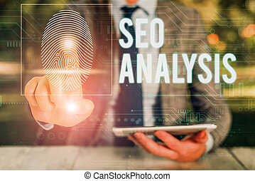 Text sign showing Seo Analysis. Conceptual photo tool helps showing to study on how to improve a website ranking Woman wear formal work suit presenting presentation using smart device.