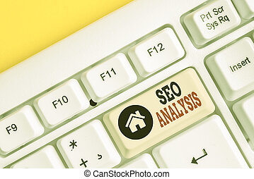 Text sign showing Seo Analysis. Conceptual photo tool helps showing to study on how to improve a website ranking White pc keyboard with empty note paper above white background key copy space.