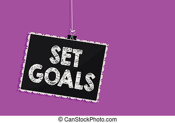 Text sign showing Set Goals. Conceptual photo Defining or achieving something in the future based on plan Hanging blackboard message communication information sign purple background.
