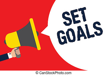 Text sign showing Set Goals. Conceptual photo Defining or achieving something in the future based on plan Man holding megaphone loudspeaker speech bubble message speaking loud.