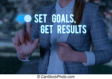 Text sign showing Set Goals Get Results. Conceptual photo Establish objectives work for accomplish them Woman wear formal work suit presenting presentation using smart device.