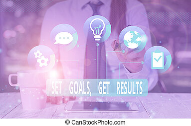 Text sign showing Set Goals Get Results. Conceptual photo Establish objectives work for accomplish them Female human wear formal work suit presenting presentation use smart device.