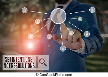 Text sign showing Set Intentions Not Resolutions. Conceptual photo Positive choices for new start achieve goals Male human wear formal work suit presenting presentation using smart device.
