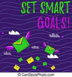 Text sign showing Set Smart Goals. Conceptual photo list to clarify your ideas focus efforts use time wisely Many Colorful Airmail Flying Letter Envelopes and Two of Them with Wings.