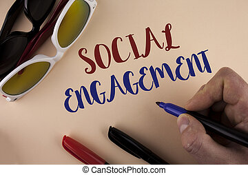 Text sign showing Social Engagement. Conceptual photo post gets high reach Likes Ads SEO Advertising Marketing written by Man on plain background holding Marker Sun Glasses and Markers next to it